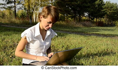 Business woman uses a laptop