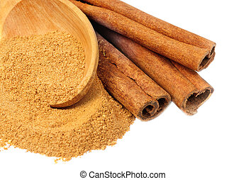 Cinnamon - sticks and powder and wooden spoon isolated on...