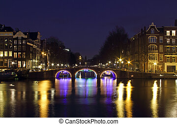 City scenic from Amsterdam by night in the Netherlands -...
