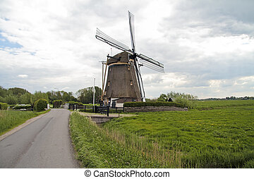 Medieval windmill in the countryside from the Netherlands