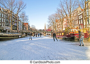 Ice skating on the canals in Amsterdam the Netherlands in...