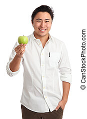 Im living a healthy life - Young man holding a green apple....