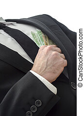 Bribery - Businessman putting banknotes in his jacket pocket...