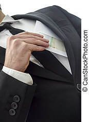 Corruption - Man putting envelope in his pocket. Metaphor...