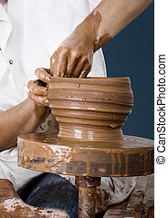 Potters art - Close-up picture of a potter works a potters...