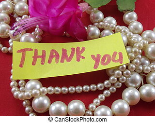 word thankyou - pearls and word thank you on redbackground