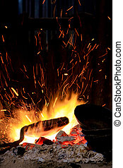 forge fire in blacksmiths where iron tools are crafted
