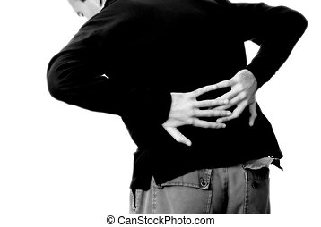 Injured Man - A young man holding his lower back in pain