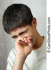 Sorrowful Teenager - Sorrowful Young Teenager crying on gray...