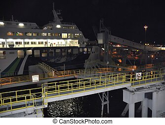 Ferry Boat at Dock - A look at a ferry boat in the harbor at...