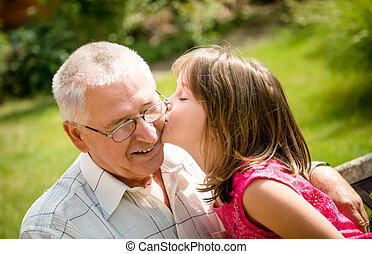 Happy retirement with grandchild - Lifestyle portrait of...