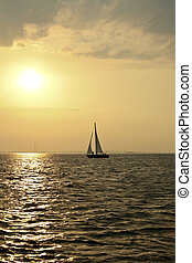sailing on the IJsselmeer at sunset in the Netherlands -...
