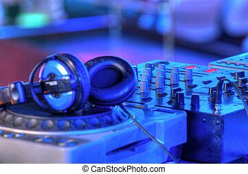 dj mixer with headphones - Djs table with audio equipment in...