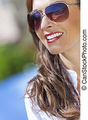 Happy Woman Wearing Aviator Sunglasses - Outdoor portrait of...