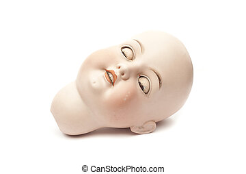 Sleeping head of porcelain doll isolated on white background...