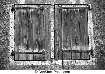 Old window shutters, a black and white photo
