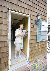 Elderly carpenter working - Elderly carpenter replacing...
