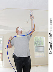 Painter spray painting - Contract painter updating colors of...