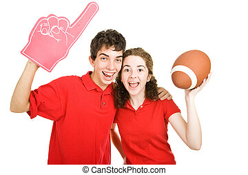 Teen Couple - Football Fans - Cute teen couple excitely...