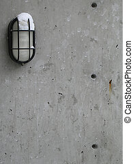 outdoor light with snow on a cement wall