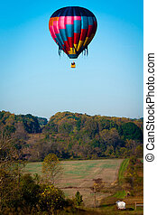 hot air balloon over farm land