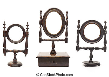 Set of antique mirrors on white background