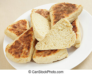 Girdle scones showing texture - Scottish girdle scones on a...