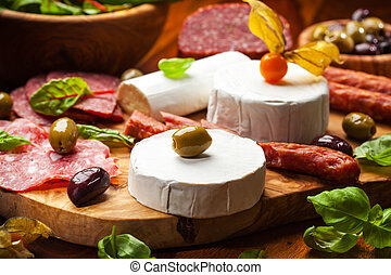 Antipasto catering platter with different meat and cheese...