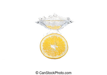 Fresh fruit dropped into water with splash on white background