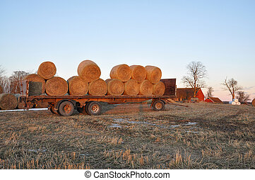 Hay bales in winter - hay bales on a trailer a frosty winter...