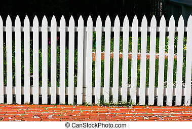 White fence surrounding a house garden in Chicago, USA