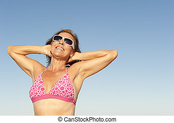 Attractive sporty mature woman isolated - Portrait...