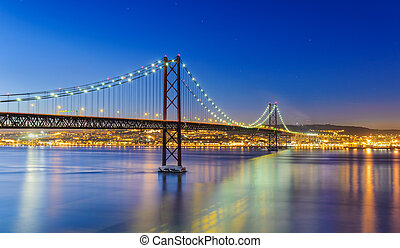 The 25 de Abril Bridge in Lisbon, P - Night view of Lisbon...