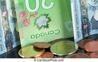Canadian money on a black background