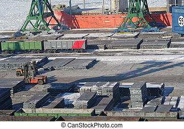 View on trading seaport with cranes, cargoes and wagons
