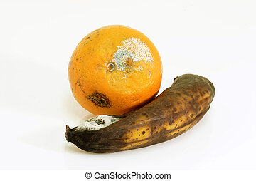 Contaminated fruits - Mouldy fruits on bright background.