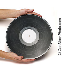 Vinil Record - Two hands hold Vinil Record white isolated.