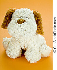 Toy dog - Cute stuffed animal on orange background