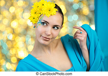 Young model with makeup and flowers in her hair