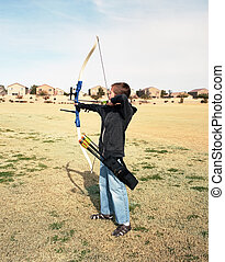 Young Archer - A young boy drawing back a bow and arrow