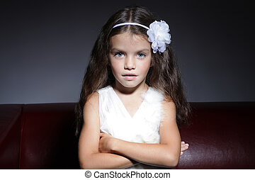 close up portrait of young beautiful little girl with dark...