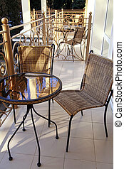 Iron table and chairs on balcony