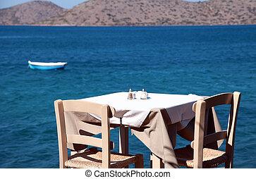 traditional greek outdoor restaurant (Crete, Greece ). -...