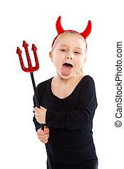 Little girl in devil costume. Studio shot.
