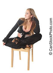 Girl sitting with crossed legs - Girl sitting on chair with...