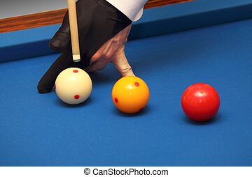 Carom billiards profi with gloves on a table