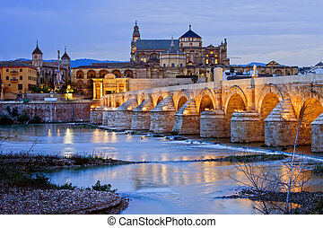 Morning in Cordoba - Roman Bridge on Guadalquivir river and...