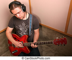 guitarist in studio - guitarist with red guitar play music...