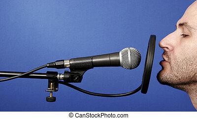 announcer - man recording voice in professional audio studio