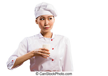 milk mustache - Asian woman chef drinking milk, milk...